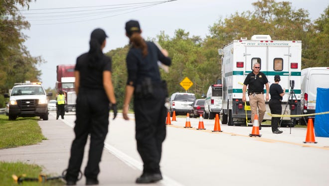 The Collier County Sheriff's Office and Miccosukee Police Department investigate a crime scene along East Tamiami Trail Thursday, October 20, 2016 in Ochopee, Fla.