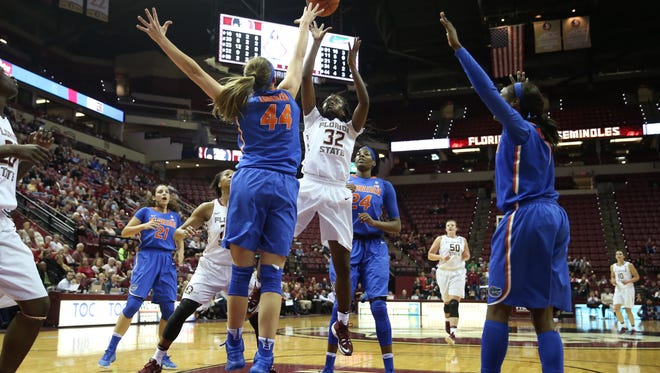 FSU's Imani Wright shoots the ball over Florida's Haley Lorenzen during their game at the Tucker Center Thursday.