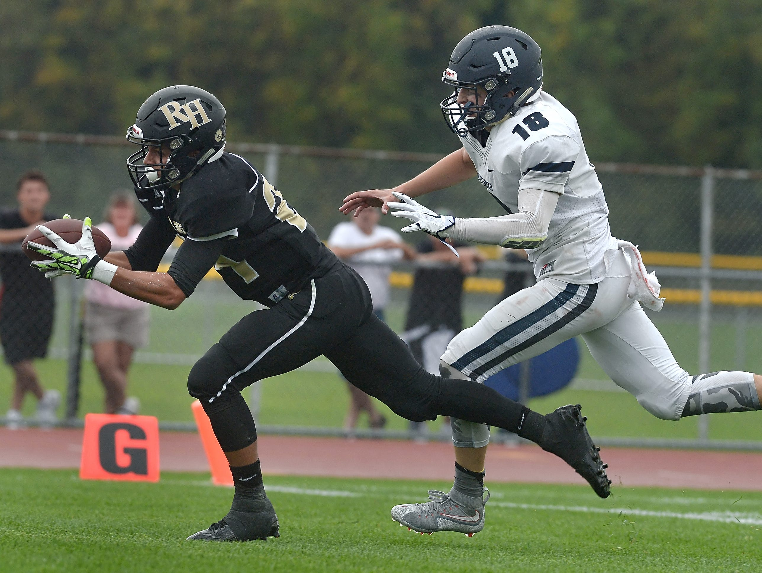 Pittsford's Colby Barker, shown here on the right defending Rush-Henrietta receiver Joseph Ortiz earlier this season, returned an interception 72 yards for a touchdown last week.