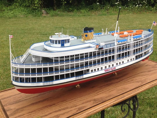 The Boblo Boat Columbia by Sam Buchanan. He is senior captain and general manager of the J.W. Westcott mail boat near the Ambassador Bridge in Detroit. In his spare time, Buchanan crafts models of Great Lakes vessels Ð by hand. He sells them to customers like museums and private collectors.