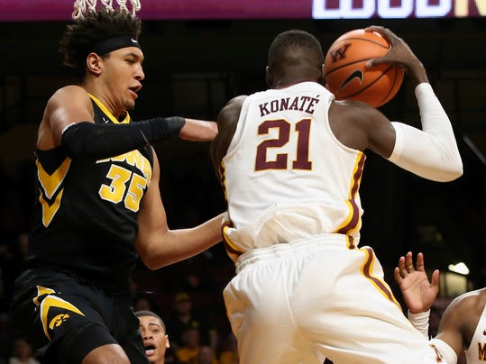 Minnesota's Bakary Konate of Mali beats Iowa's Cordell Pemsl, left, to the rebound in the first half of an NCAA college basketball game Wednesday, Feb. 21, 2018, in Minneapolis. (AP Photo/Jim Mone)