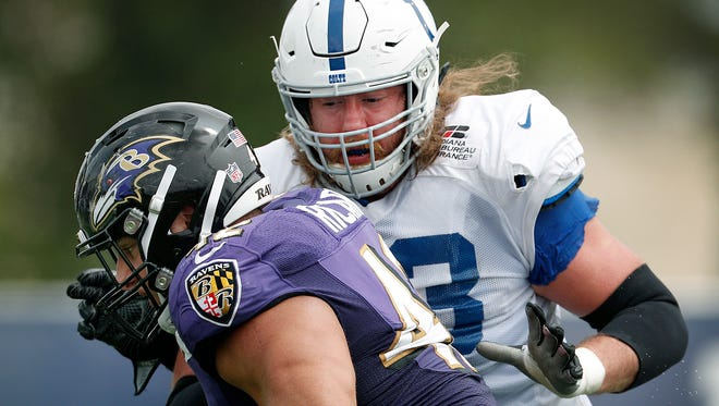 Indianapolis Colts offensive tackle Joe Haeg (73) works on blocking  Baltimore Ravens defensive tackle Patrick Ricard (42) during the Colts and Ravens joint practice at Grand Park in Westfield on Saturday Aug 18.