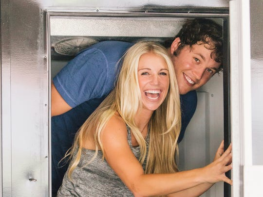 Matthew Stafford and Kelly Hall pose for an engagement