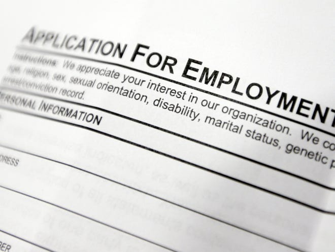 This April 22, 2014, photo shows an employment application form on a table during a job fair at Columbia-Greene Community College in Hudson, N.Y. The Labor Department said Friday, May 2, 2014, that U.S. employers added a robust 288,000 jobs in April, the most in two years, the strongest evidence to date that the economy is picking up after a brutal winter slowed growth. (AP Photo/Mike Groll) ORG XMIT: NYBZ169