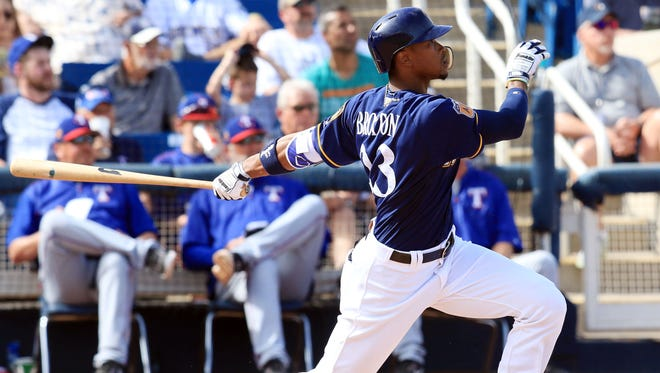 Keon Broxton watches his three-run homer leave the ballpark during the fifth inning Saturday in Phoenix.