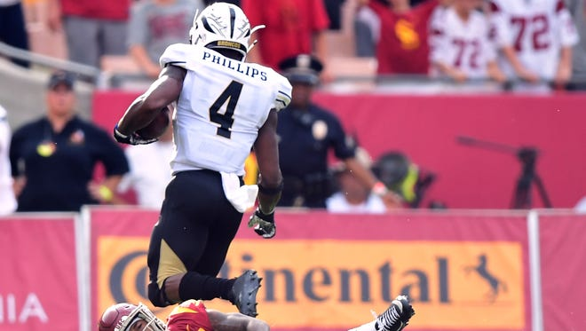 Western Michigan's Darius Phillips returned a kickoff for a touchdown to tie the score 28-28 during the fourth quarter Saturday at USC.