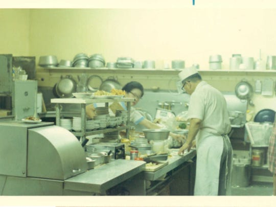 Frances and Henry Ojima work at their Soo Hoy Café in Port Orchard. The Ojima family owned the popular restaurant for many years until they sold it after Frances' death in 2000.