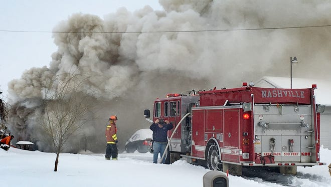 Nashville Volunteer Fire Co. and other fire companies battle a garage fire on Wednesday, March 15, 2017.