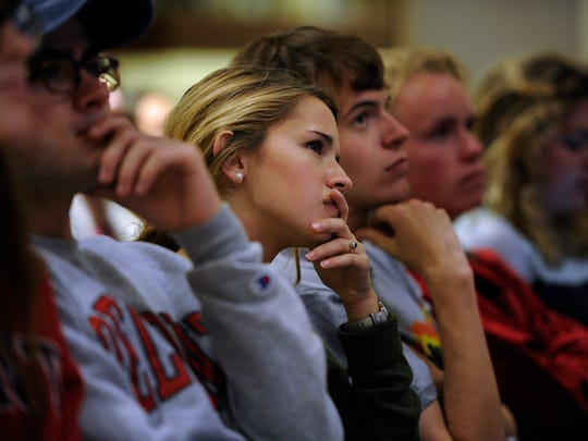 Belmont student Juliana Fernandez listens to presidential candidates Donald Trump and Hillary Clinton during a debate watch party at Belmont on Monday, Sept. 26, 2016.
