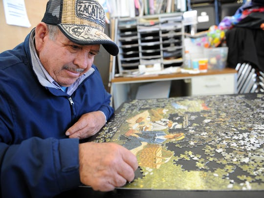 At the Firehouse Recreation Center in east Salinas, retired agricultural laborer JosŽ Urquizo works on a 1,000 piece puzzle.