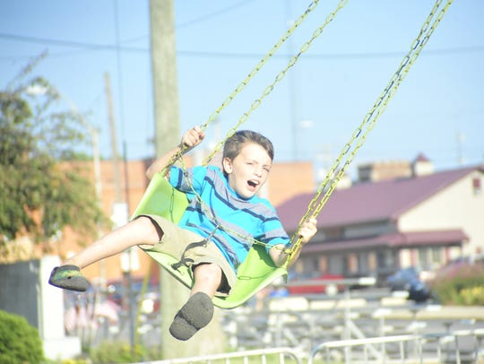 Thomas James Thornsberry, of Willard, rides the swings during the 2017 Bucyrus Bratwurst Festival.