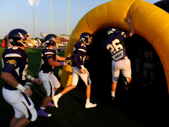Peyton Wood slaps the top of the inflatable Wylie High