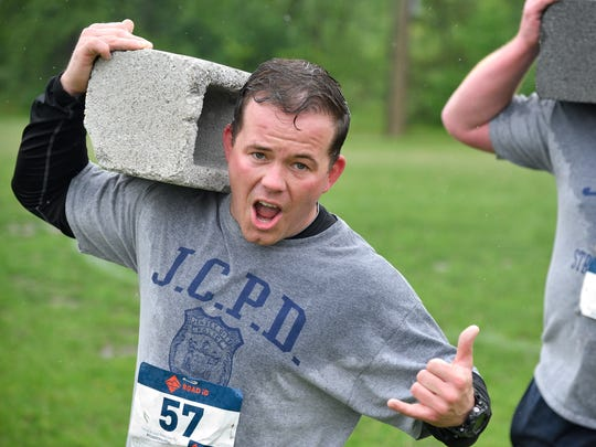 Gary Griffin carries a cinder block at the Battle of
