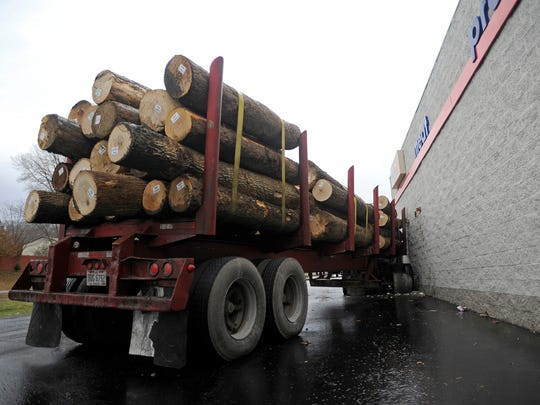 A logging truck crashed into the side of Save-A-Lot Saturday morning due to bad road conditions.