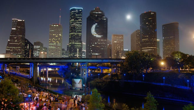 "The Downtown skyline serves as the backdrop to an event along Buffalo Bayou. The park's major trails are illuminated with lunar lighting that mimics the moon's waxing and waning cycles by turning from white to blue, ""channeling Houston's tie to NASA,"" says Holly Clapham, vice president of marketing for the Greater Houston Convention & Visitors Bureau."