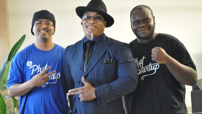 Phat Startup co-founders Anthony Frasier, right, and James Lopez flank Melvin Glover, also known as Grandmaster Melle Mel.