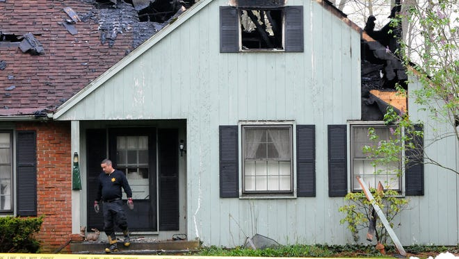 The scene Tuesday morning at 561 Laughbaum Drive in Galion, where two people died in a fire reported just before 1 a.m.