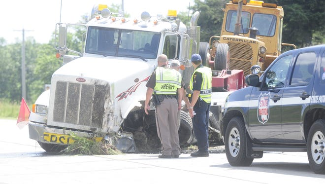 Emergency personnel respond to the scene of a vehicle versus semi trailer crash Wednesday, July 15 along Highway 23 near Tower Road in Fond du Lac County.