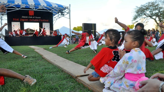 In this file photo, children watch a performance by students of Japanese School of Guam at the Autumn Festival.