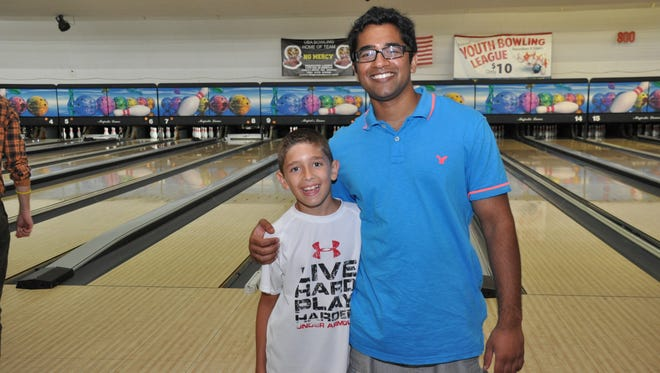 Big Brother Shivang Bhatt with mentee Jordan at last year's Bowl For Kids' Sake. This year's event takes place this weekend and next.