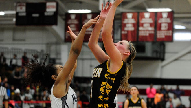 Waupun's Maiah Domask puts up a shot during the Warriors' WIAA Division 3 sectional final against Milwaukee School of Languages on Saturday at Waukesha South.