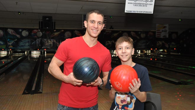 Nick Boscia (left) and Aiden also hit the bowling lanes together.