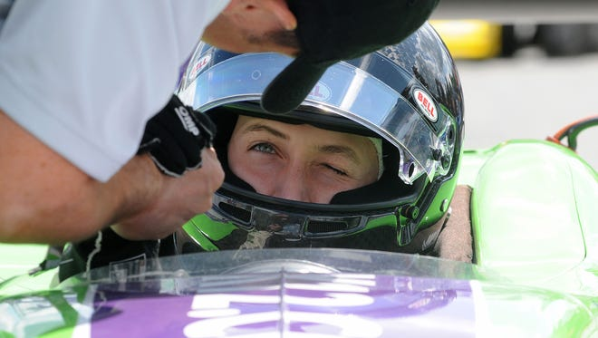 Zach Veach winks and shakes hands with his father Roger before the start of the Indy Lights race at Mid-Ohio in 2013.