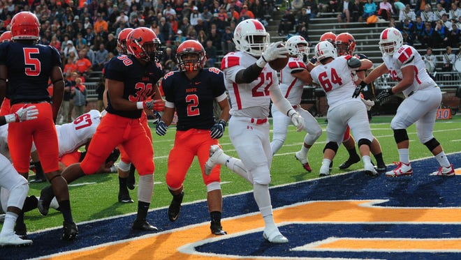 Olivet College running back Tyler Mojet scores against Hope College on Saturday.