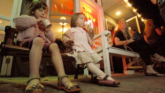 "Nina, 5, and Ruby Josephson, 2, are part of the crowd of families outside The Towne Scoop enjoying Family Night specials. ""Dinner Makes Difference "" is the slogan of the Verona Municipal Alliance for Family Night in March 2012."