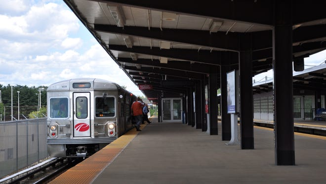 A PATCO Hi-Speedline  train stops at Woodcrest Station in Chery Hill