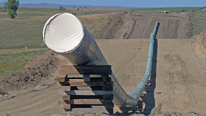 FILE - This Sept. 29, 2016, file photo, shows a section of the Dakota Access pipeline under construction near St. Anthony in Morton County, N.D. The Dakota Access pipeline system leaked about 100 gallons of oil in western North Dakota in two separate incidents in March as crews worked to get the four-state line ready for operation. They're the second and third known leaks on the disputed $3.8 billion pipeline.