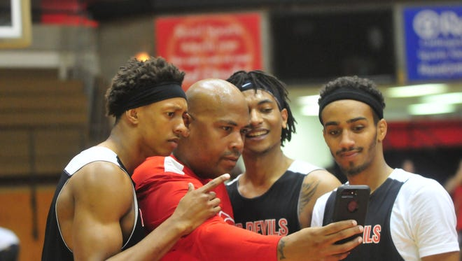 Richmond High School graduates Jai Wright, from left, David Cruse, Davious Webster and Isaiah Rader during a reunion game at Tiernan Center Friday, June 30, 2017. The 30-and-under age group, coached by Curtis Wright, defeated the 30-and-over age group, coached by Billy Wright, by the score of 63-57.