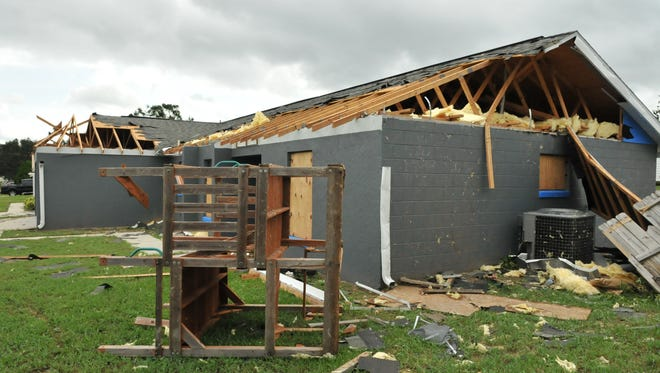 Scenes from Monday after a Hurricane Irma spawned tornado his hit several homes in Mims, in North Brevard County.