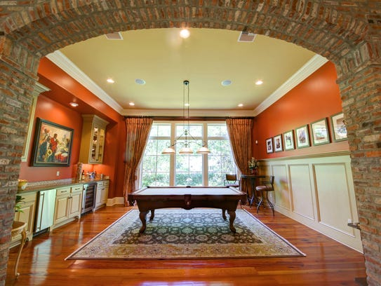 The billiards room could also be a formal dining room.