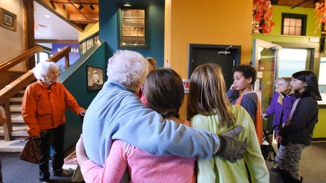 Endeavour students hugging Wake Robin residents goodbye and thanking them for their visit.