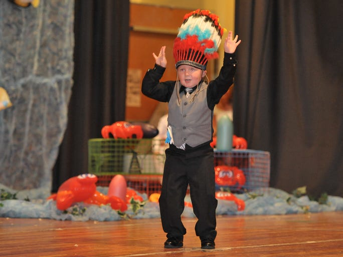 Ashton Decker dances during the annual Little Miss and Mr Crustacean Pageant held at Crisfield High School.