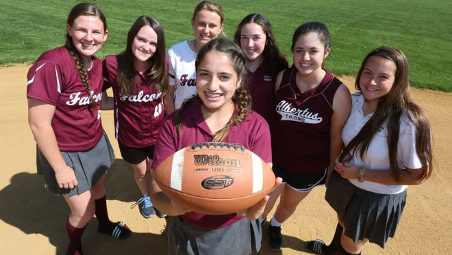 Albertus Magnus softball player Joana Garafolo with Wilson, the football she found that became the team's good luck charm at the school May 31, 2016. The girls found him before stunning Rye Neck in the playoffs, and kept him to play touch football with before reaching the section finals as a 15-seed.