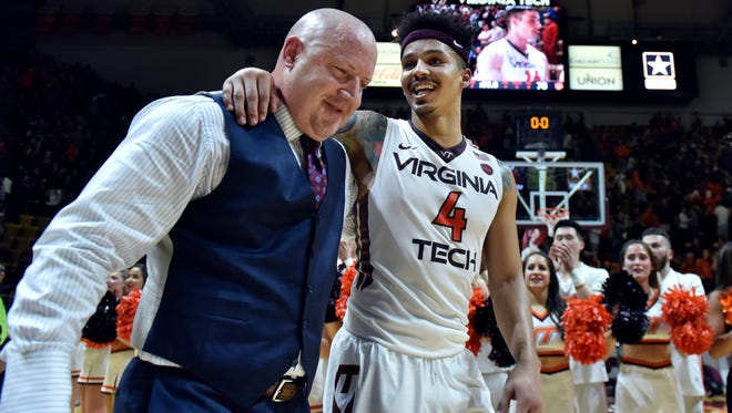 Virginia Tech guard Seth Allen hugs head coach Buzz Williams as they leave the floor following a victory against Clemson this season.