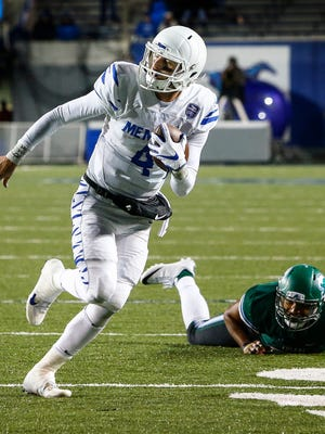 University of Memphis quarterback Riley Ferguson (left) scrambles past Tulane University defender Quinlan Carroll (right) for a touchdown during fourth quarter action in Memphis, Tenn., Friday, October 27, 2017.