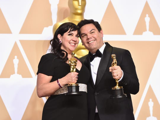 Composers Kristen Anderson-Lopez and Robert Lopez,
