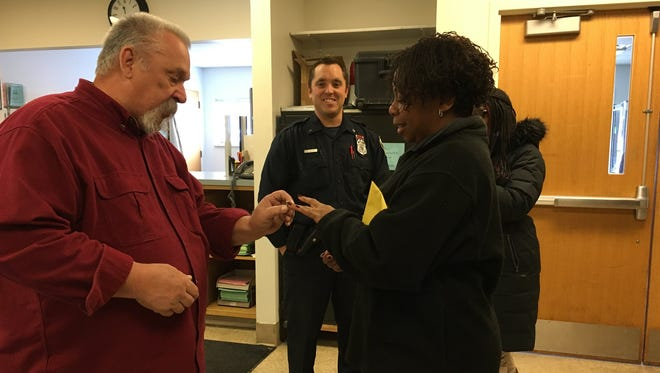 Dennis Schneider, whose son is a Milwaukee police officer, found a woman's missing wedding ring in the snow and returned it to her Friday.