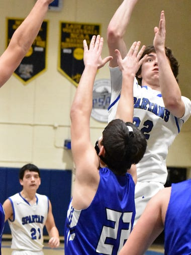 McConnellsburg's Chance Hawbaker reaches for the basket