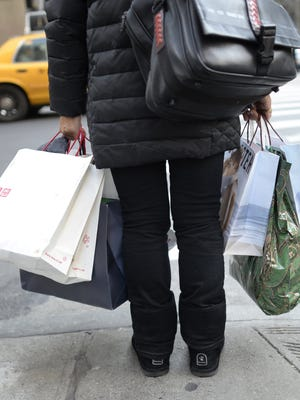 A shopper is loaded down on 5th Avenue in New York.
