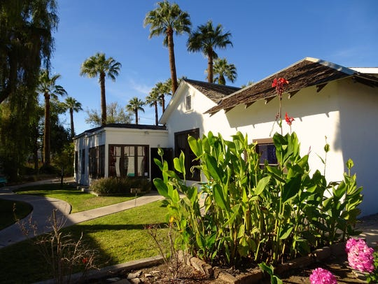A charming 19th century adobe surrounded by lush gardens
