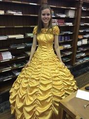 Cara Szymanski poses in the yellow dress her boyfriend