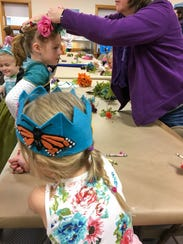 "Girls assemble nature crowns during ""Be a Nature Princess"""