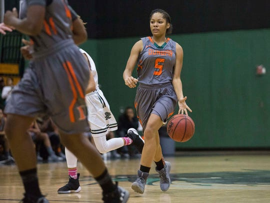Dunbar's Shania Church dribbles the ball down the court