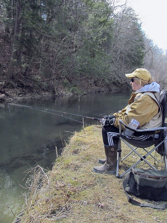 The author's fully pregnant wife Erin watches her line drift in Quittapahilla Creek during the opening day of trout season, which was  also the anticipated due date for Baby Frantz.