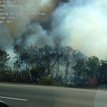 A brush fire has caused one lane of I-95 near Grant