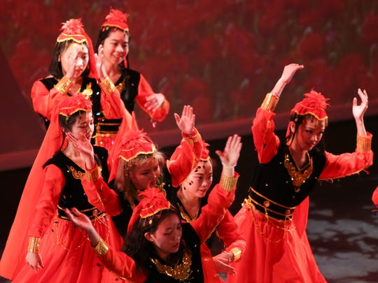 Members of the University of Delaware Dragonfly Dance Club perform as part of the university's Chinese New Year celebration Saturday evening at Mitchell Hall. The Year of the Dog began Friday on the Chinese calendar.